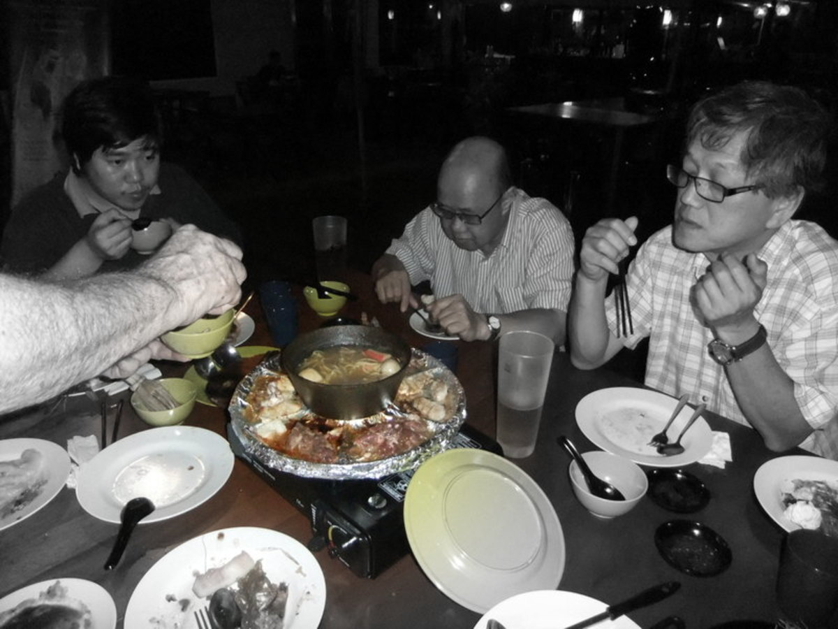 My friends enjoying seafood dinner at KK waterfront