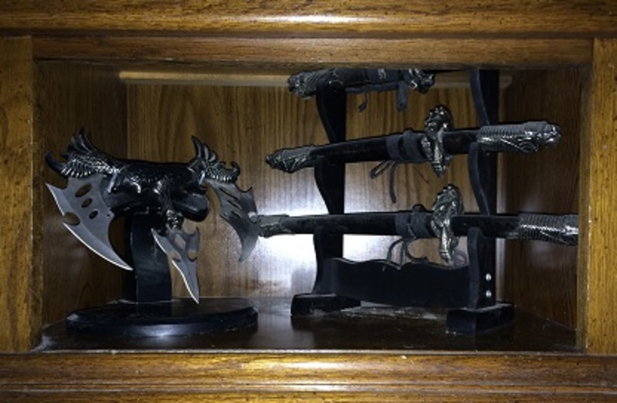 A unique knife on display next to small samurai swords.