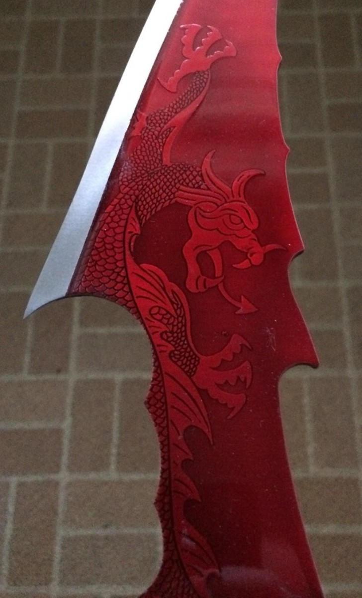 An unusual design of a dragon on the blade of a knife.