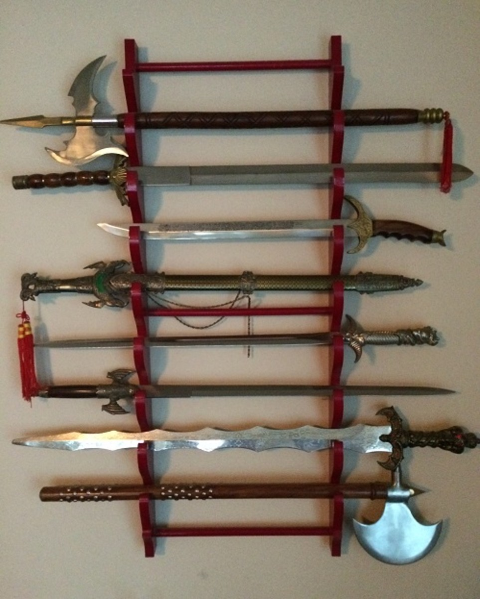 A closer look at my sword collection which is securely mounted to a wall.