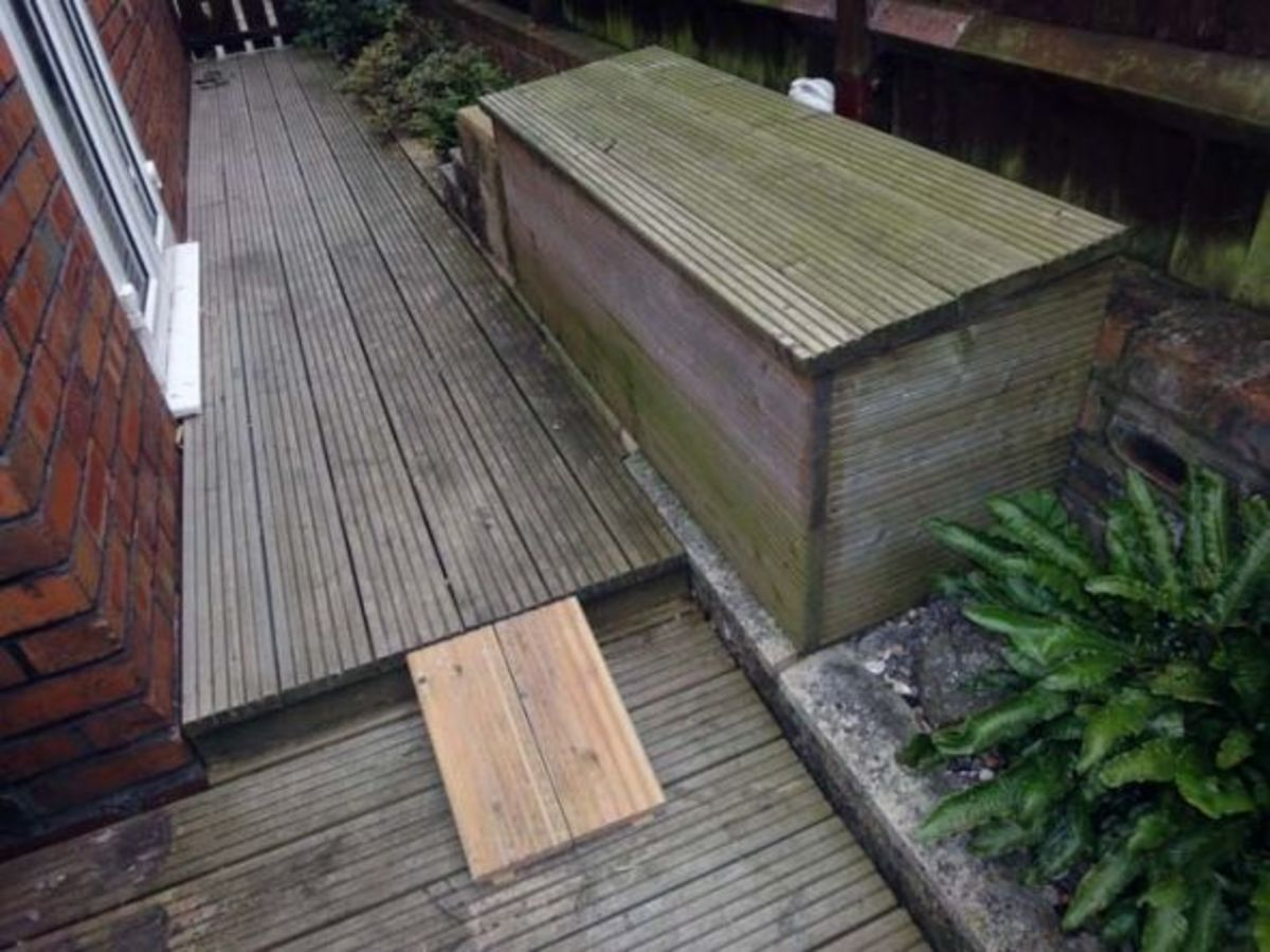 Recycle bin and lid decked out in decking off cuts.