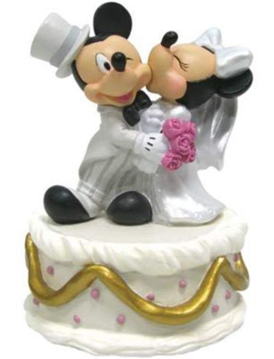 Minnie kissing Mickey on their wedding day