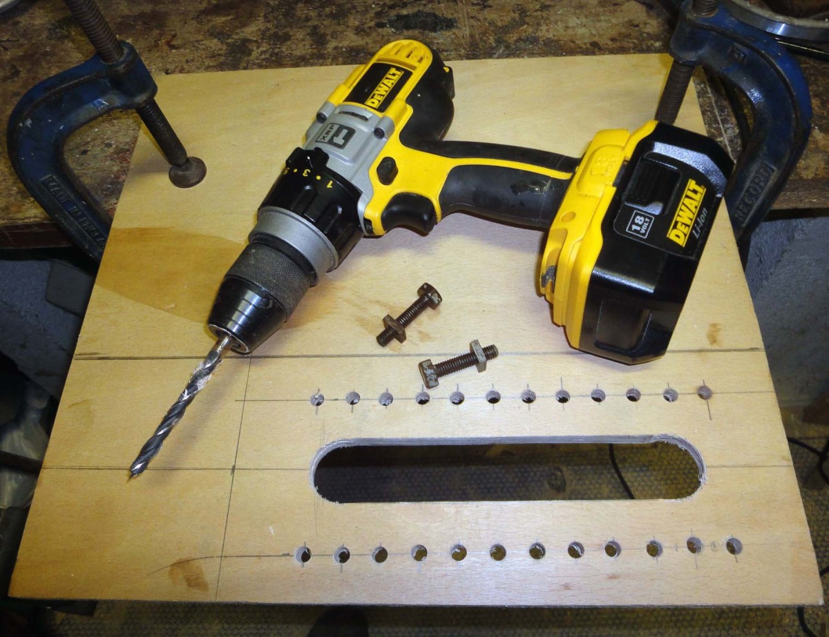 Drill holes on either side of the slit, slightly larger than the diameter of bolts.
