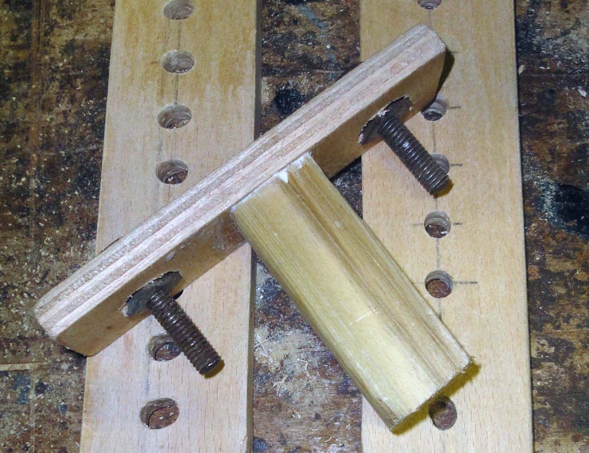Make a simple T shape peg from wood and secure bolts at either end with nuts.