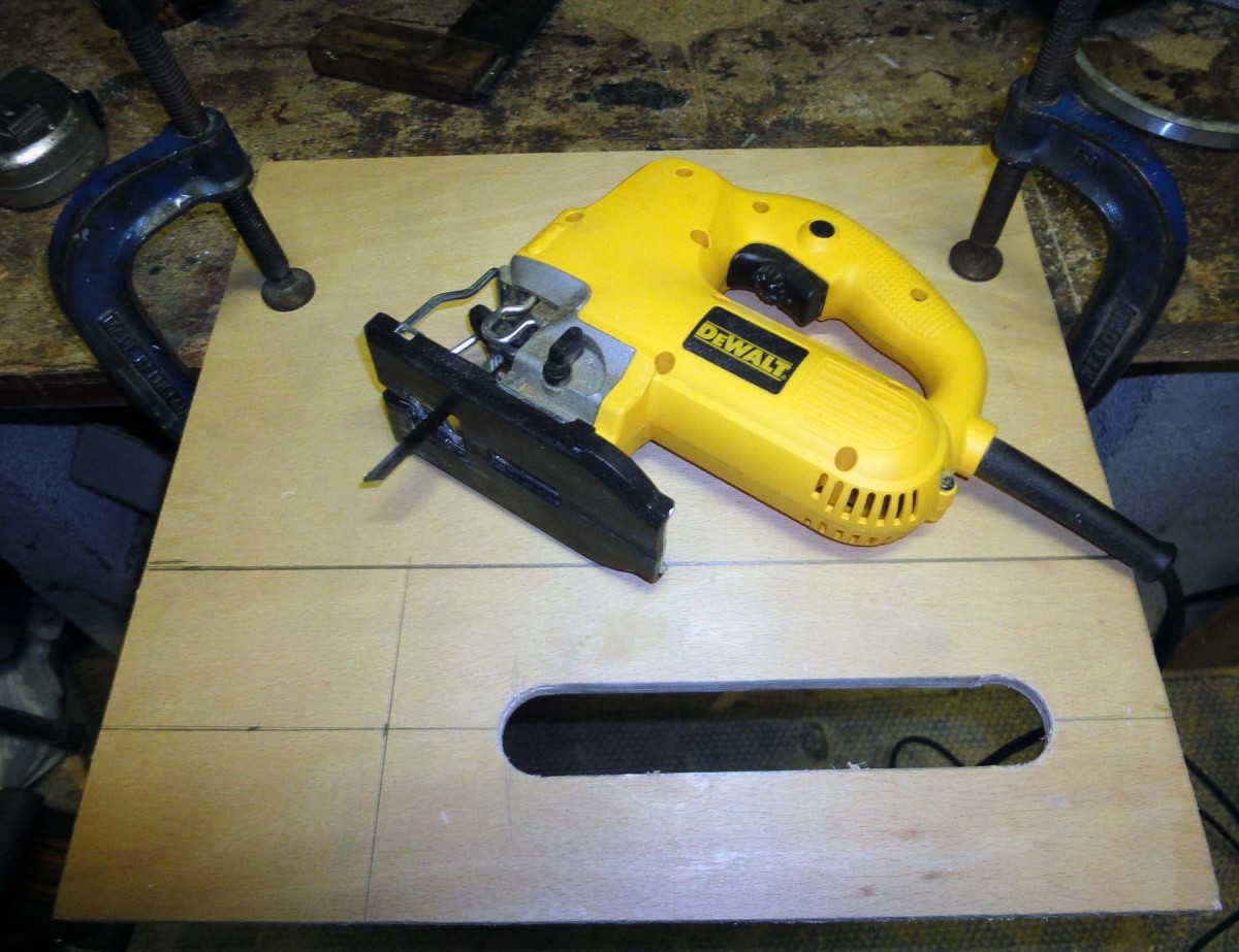 Use a jig saw to cut a slit between the two holes.