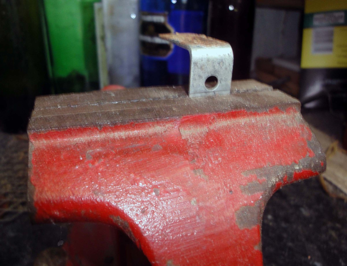 Band the angle brackets in a vice.