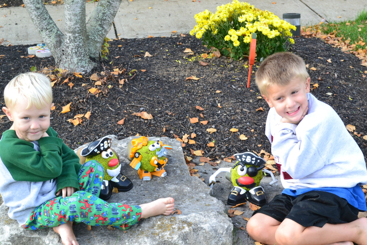 The kids were eager to show off their Mr. Potato Head Osage Oranges