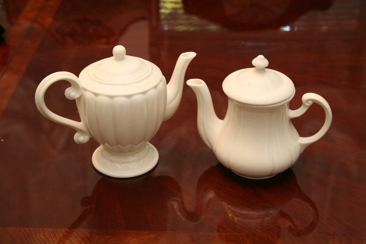 Victorian teapots gracing a table. This is what you use for teaparties with little, matching cups from which you sip with pinky finger aloft.