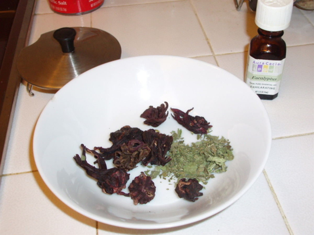 Choose herbs and essential oils. Pictured here are rose hips, mint leaves, and eucalyptus oil (in the little bottle).