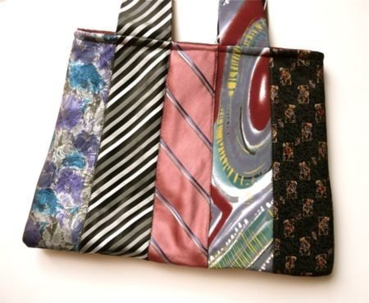 #1 - The ties from the body of this Handbag extend up to become the handles of the purse giving it nice flow. This is a great design from CraftyPod!