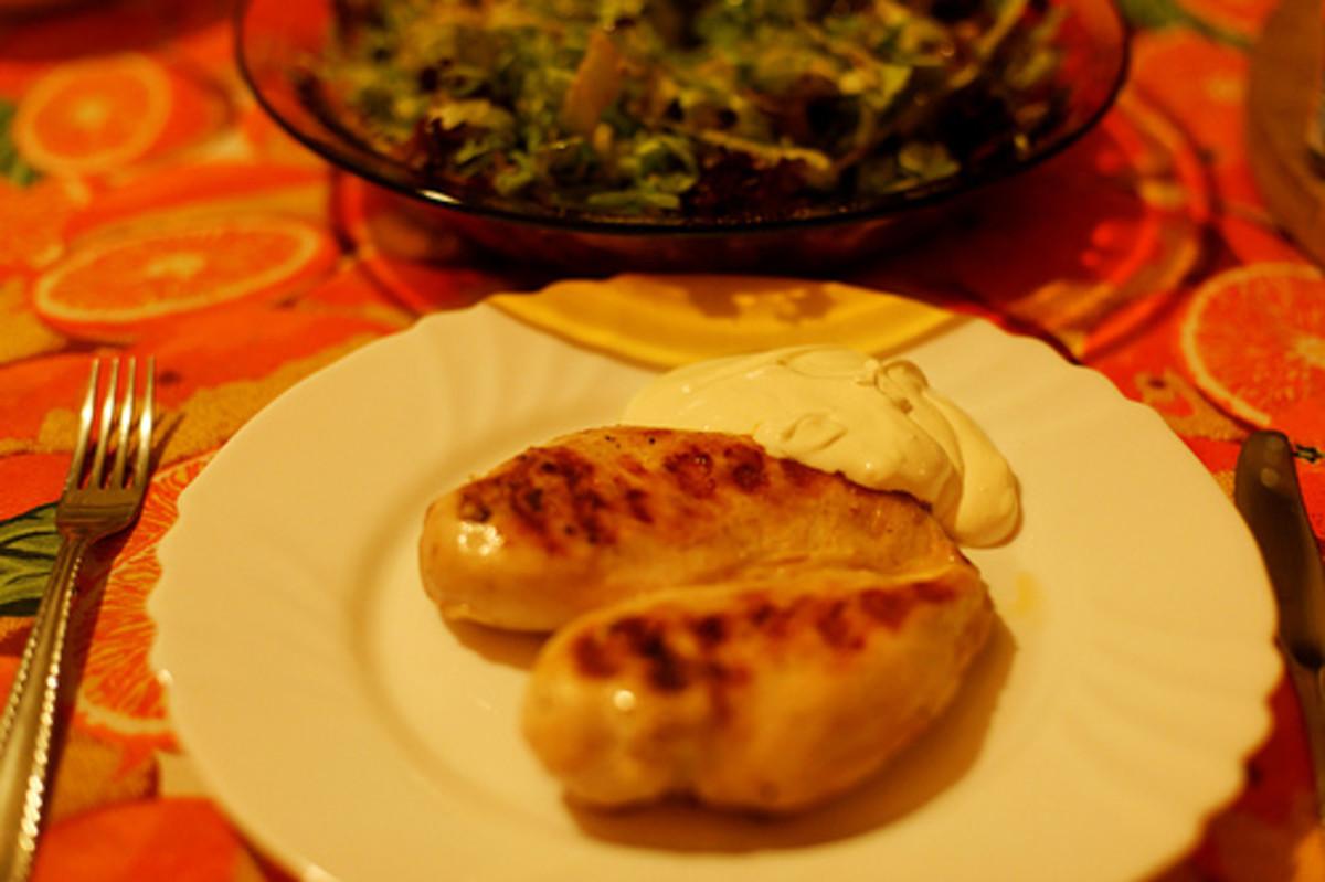 Marinated chicken breast with iceberg salad.