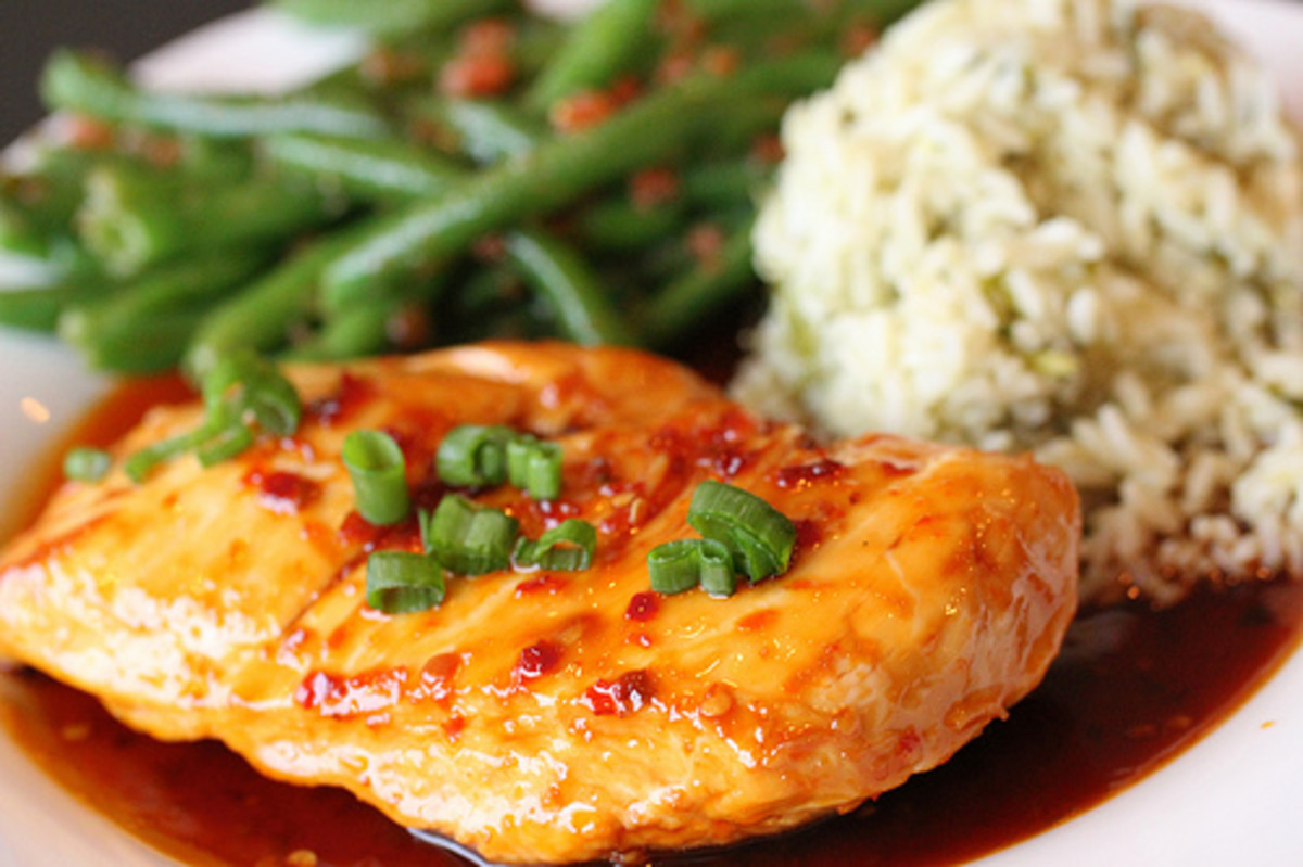 Skillet glazed marinated chicken breast garnished with scallions.  Served with ginger cilantro rice and gazpacho green beans.
