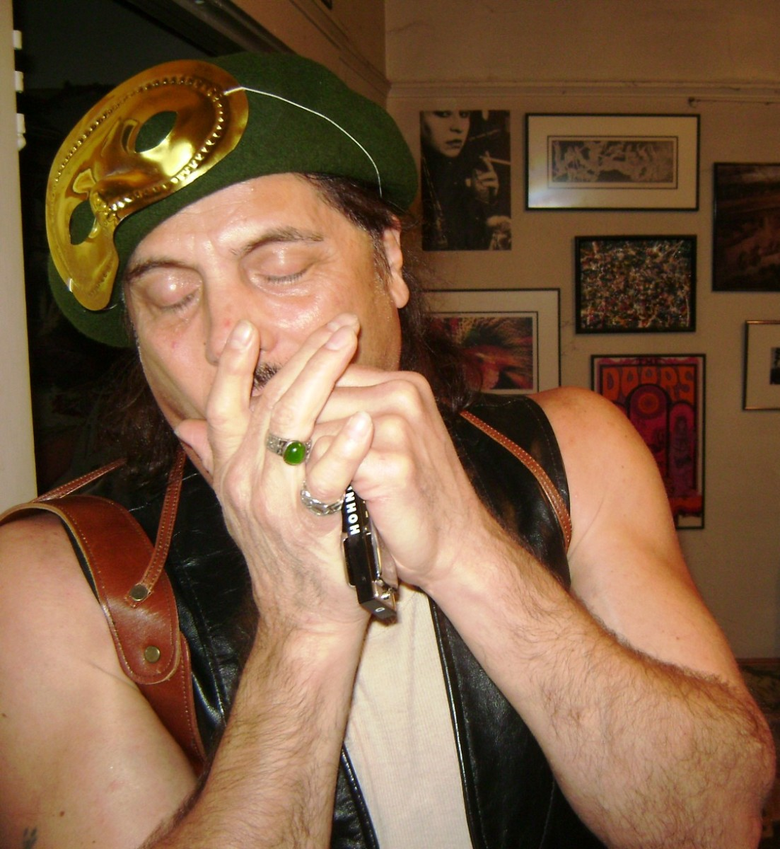 Luke plays the harmonica