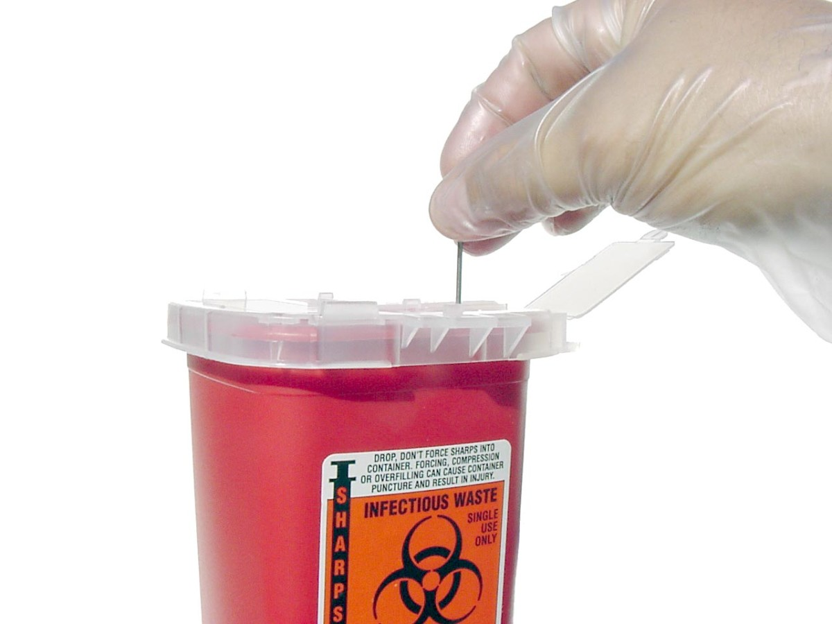 Disposing needles and samples in a sharps container is standard procedure used by scientists. As you can see, the biohazard sign is labelled on this container.