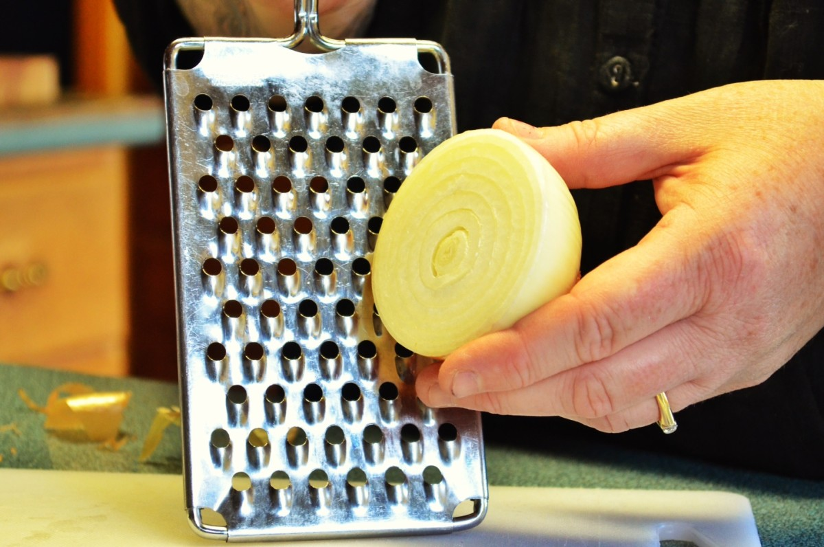 Grate an onion to create a healing paste