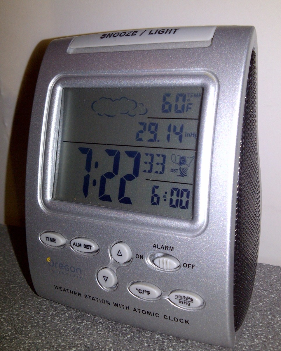 Oregon Scientific alarm clock with barometric pressure sensor and thermometer provides weather forecasts
