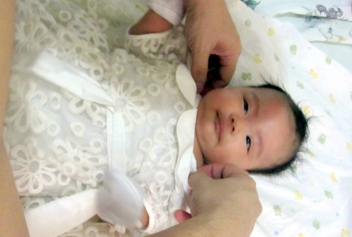 Wearing her baptism clothes from SM Makati