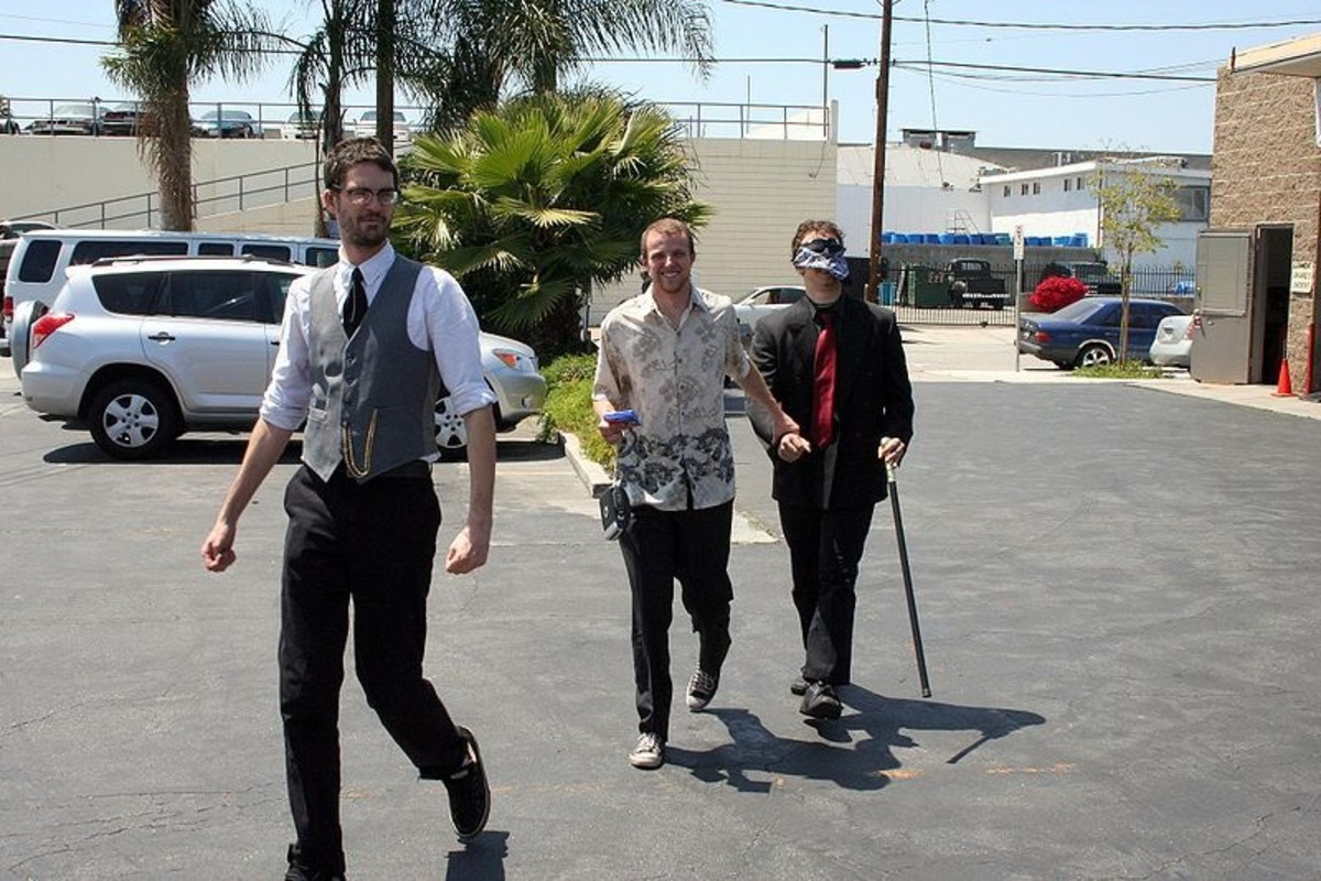 Groom Being Led To Bachelor Party Blindfolded