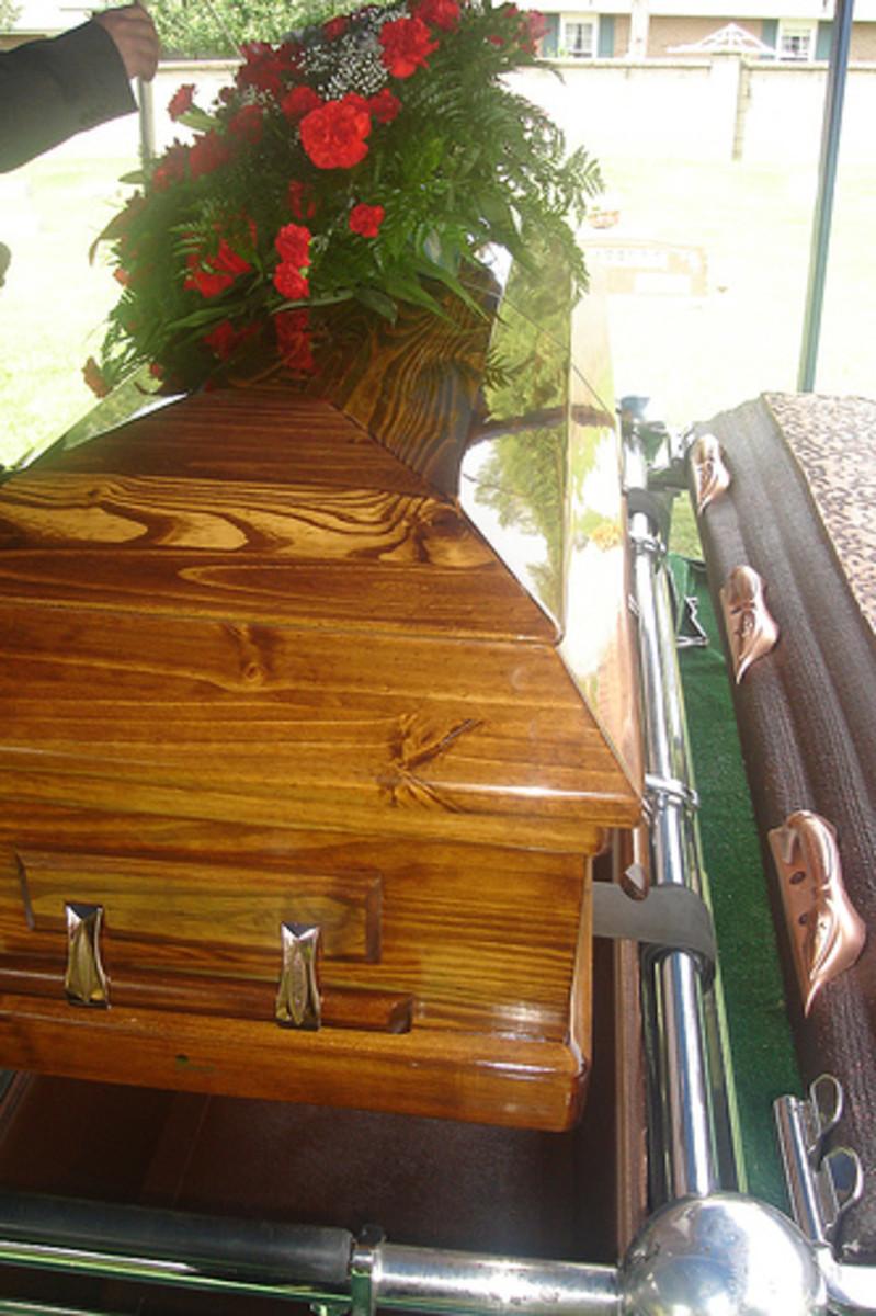 Casket, at grave