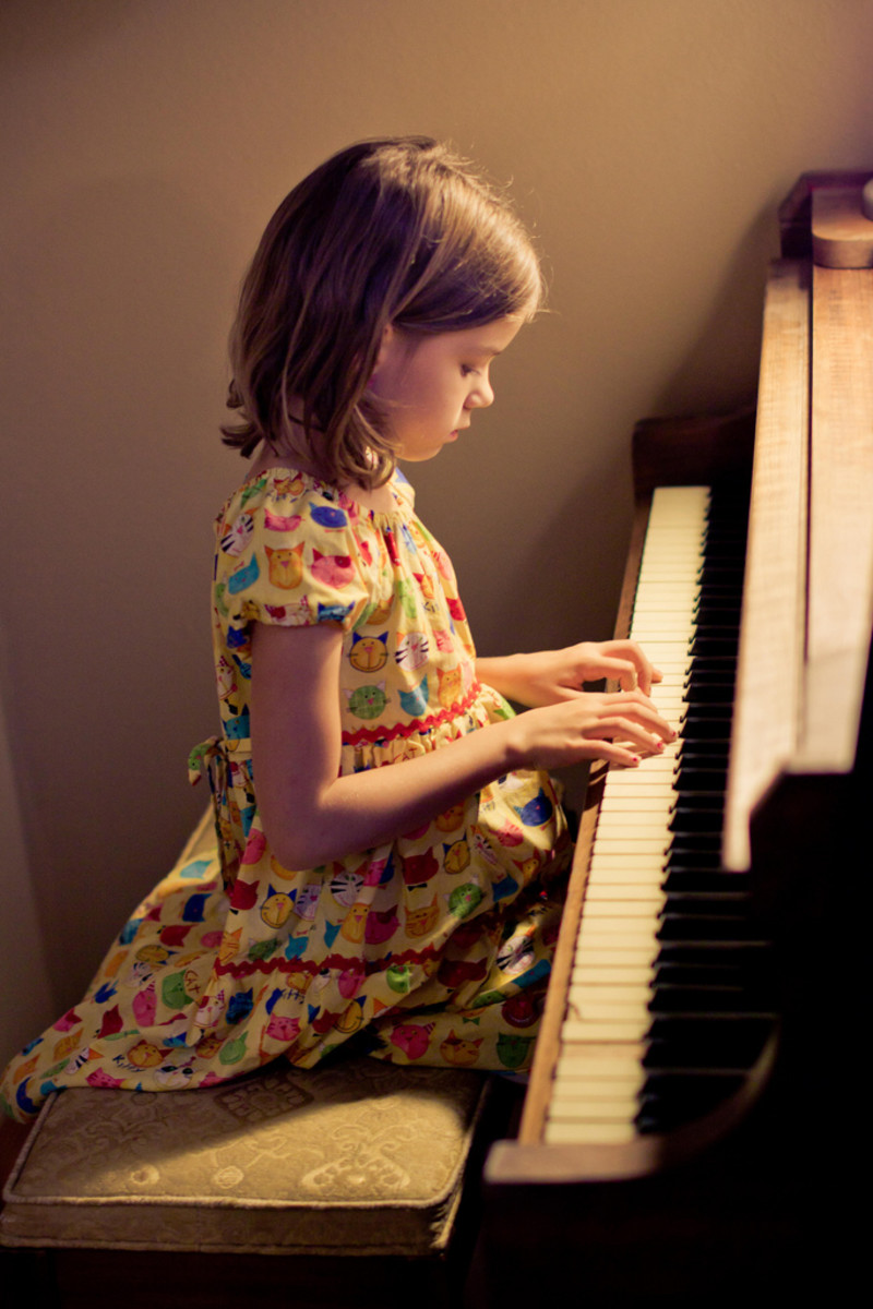 Children can start learning to play the piano at an early age