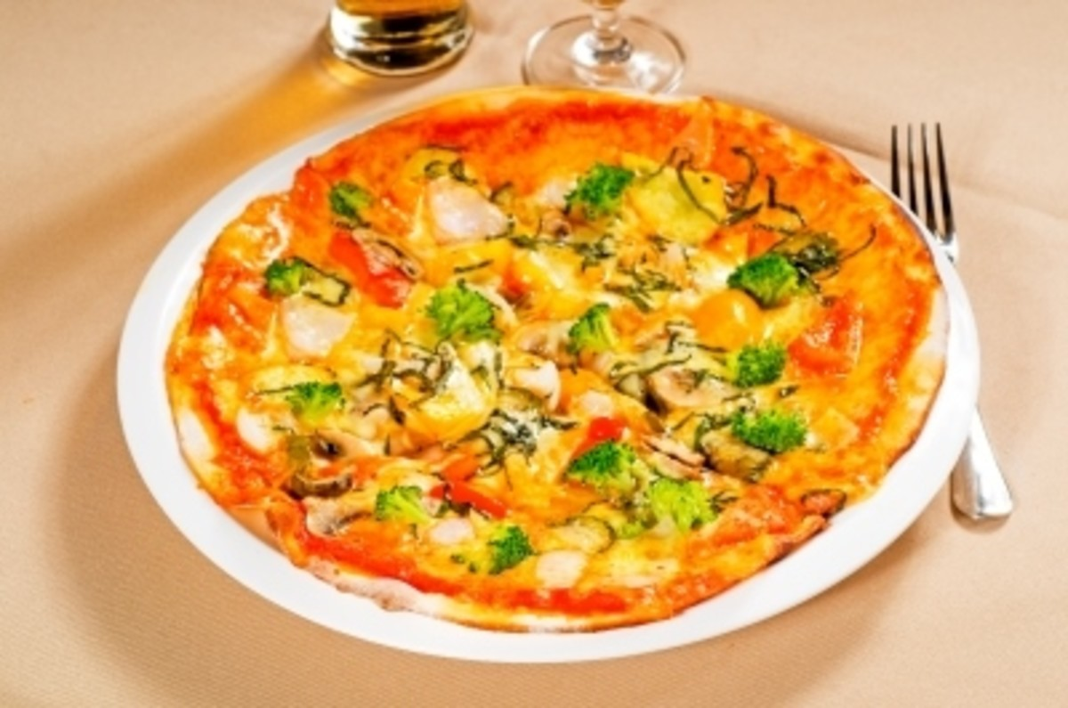 Healthy pizzas can be made at home, with fresh ingredients, less sodium, whole wheat and less fat/cheese.