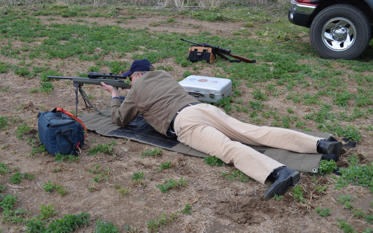 Ed aims the bolt action Howa .223 rifle at a jackrabbit 184 yards away.