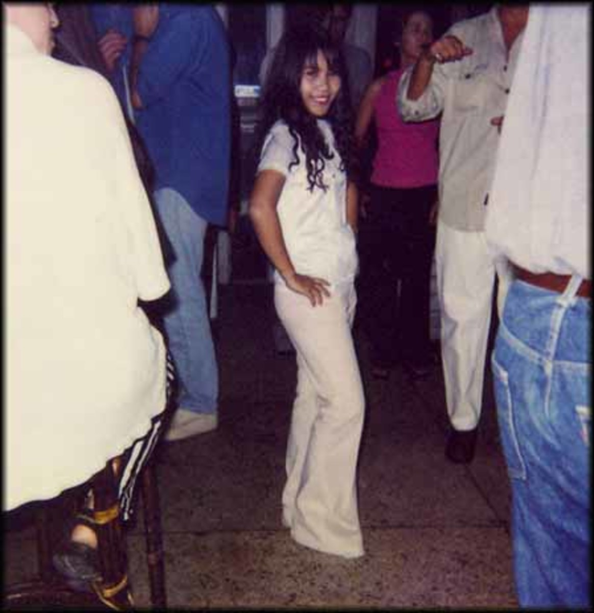 Loon, aged 15, waits for customers in a Bangkok nightclub two years after selling her virginity for a few hundred dollars