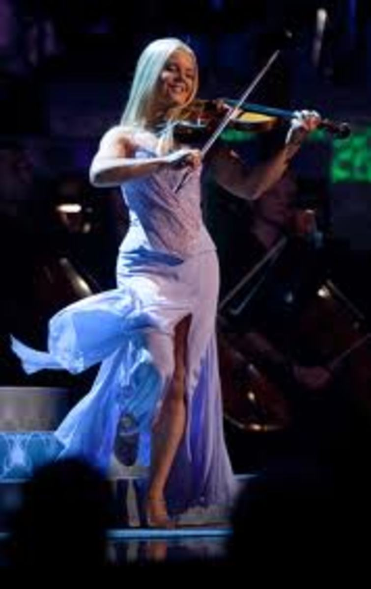 The multi-talented Mairead Nesbit, who sings and plays the fiddle as she hops and dances around the stage.  What energy she has!