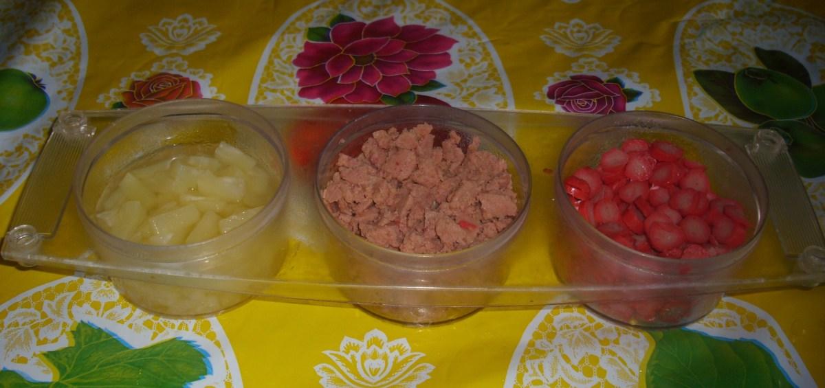 Pineapple chunks, sliced beefloaf and sliced hotdogs