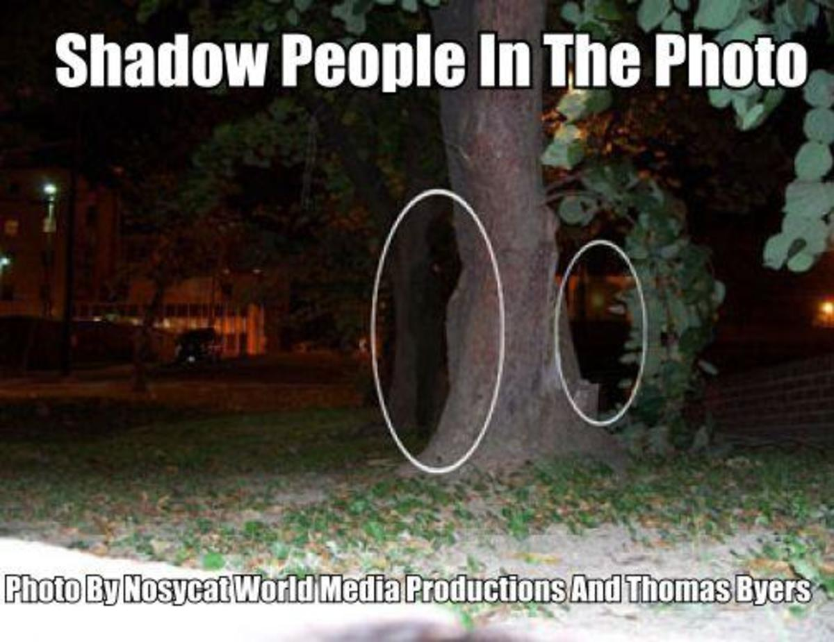 A Shadow Person is clearly standing where both figures are circled in the above photo taken in a hospital yard in Tampa Florida.