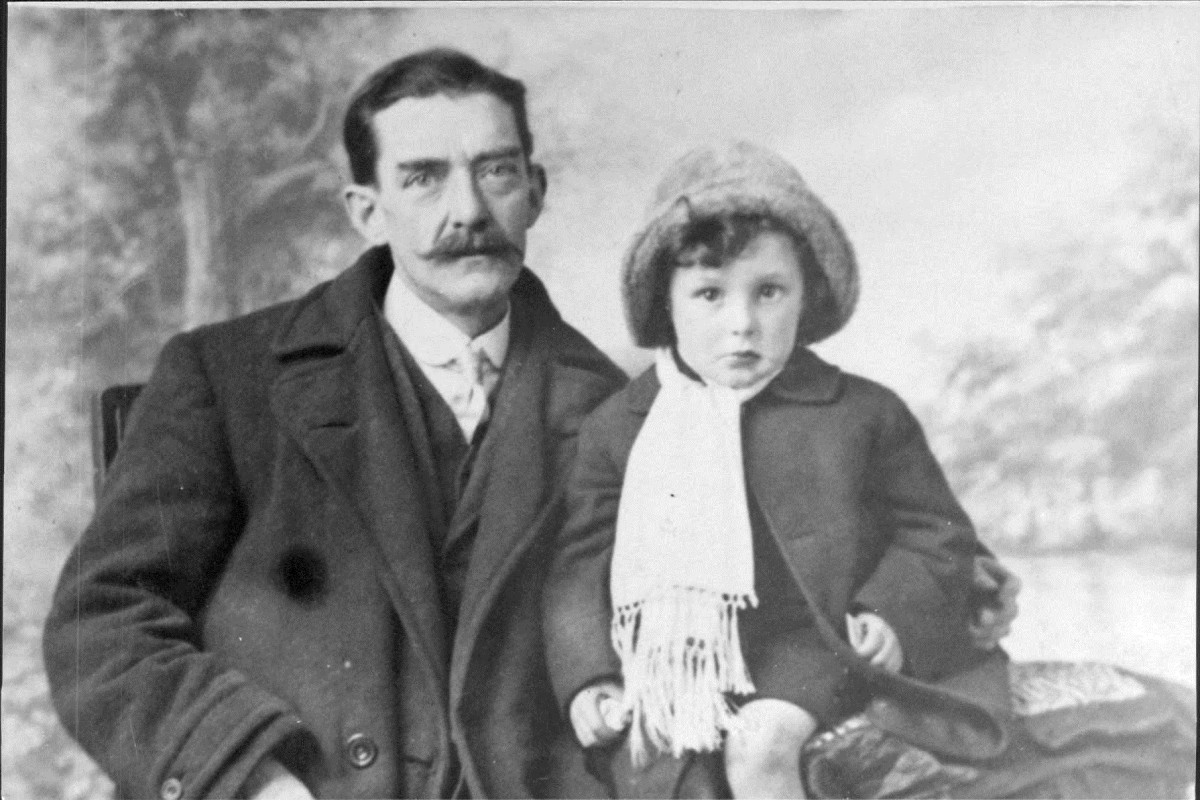 Grandad's father with daughter Mary Triggs. This appears to be a posed photograph taken in a studio.