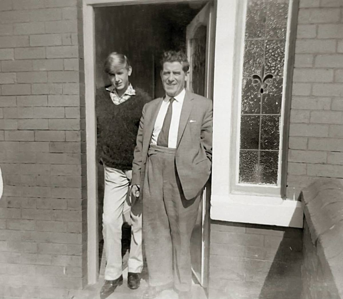 Grandad with my brother Eric at the house where we grew up. Grandad is dressed as I remember him, always in a suit and tie and never 'casual'.