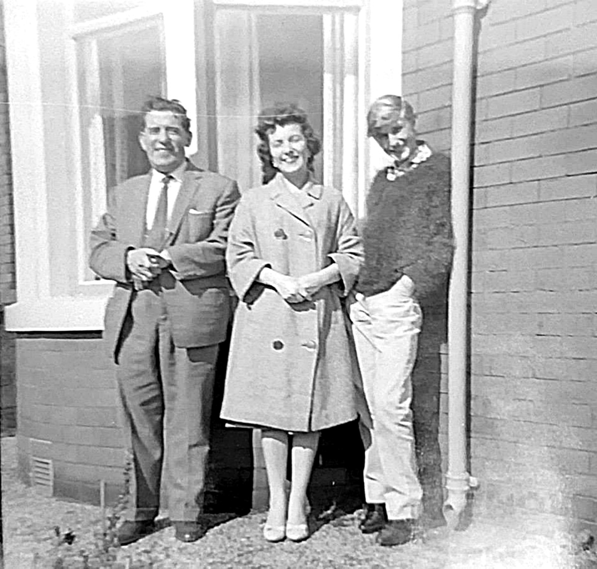 Grandad, mum and my brother Eric outside the house where we grew up in Rectory Road, Blackpool