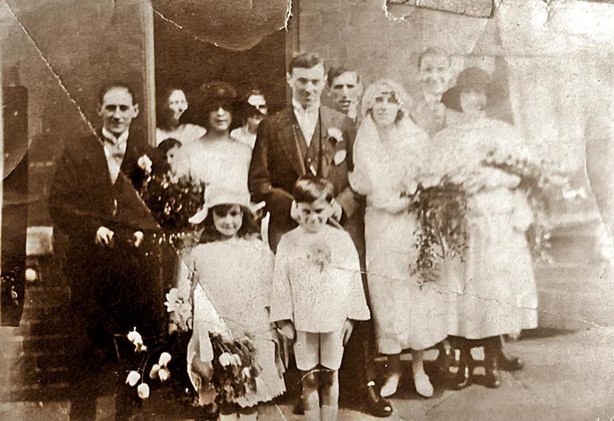 Grandad's sister, Annie Triggs, on her wedding day to John Willie Peck. Annie's sister Mary and her husband Bob Copley are to their left, behind the children. Their older brother Arthur is at the back, behind the bride and groom.