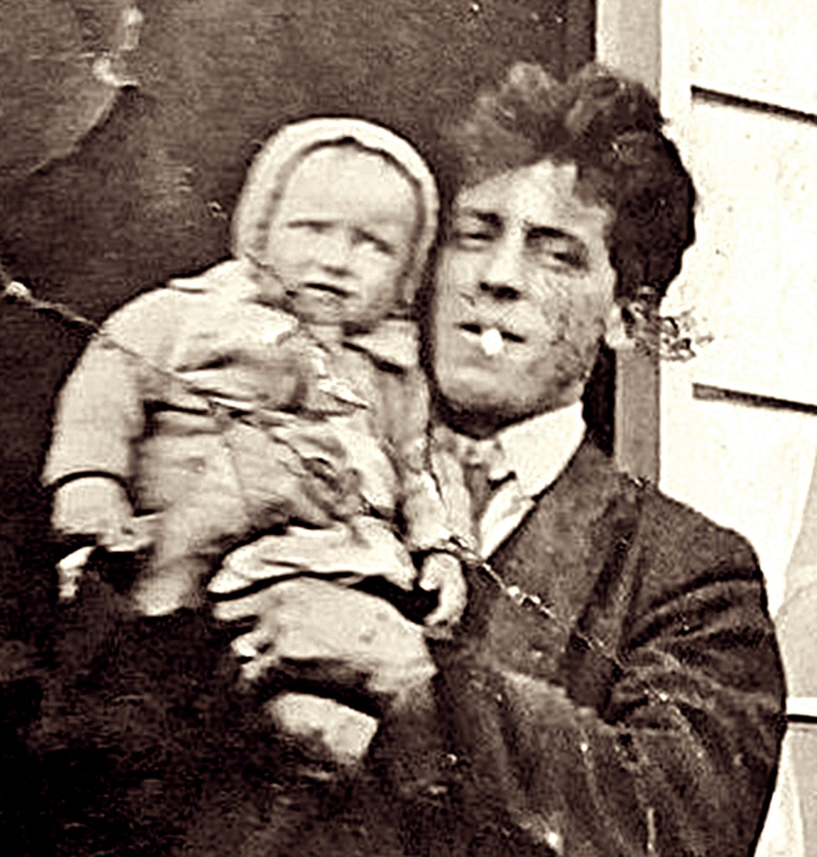 Grandad pictured with mum as a baby