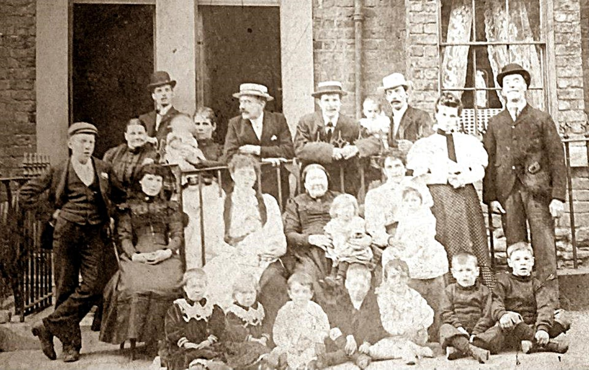 This photo shows the Triggs family, pre-1910. Grandad is one of the little boys sitting on the front row. His father is standing at the back, far right. My great, great grandma is the lady in black, sitting in the centre.