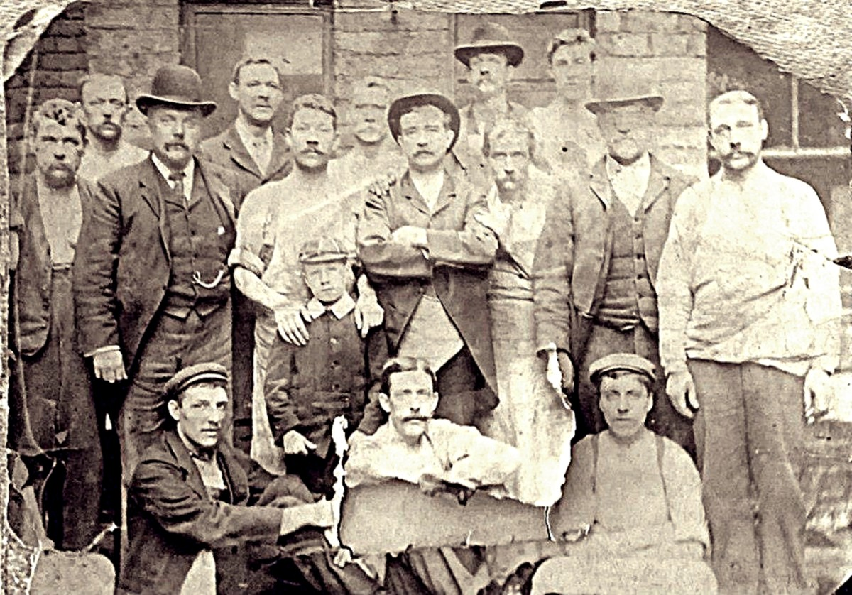 Grandad's father (pictured with workmates, we believe) in the early 20th century. His dad is the tall chap right at the back, wearing a hat.