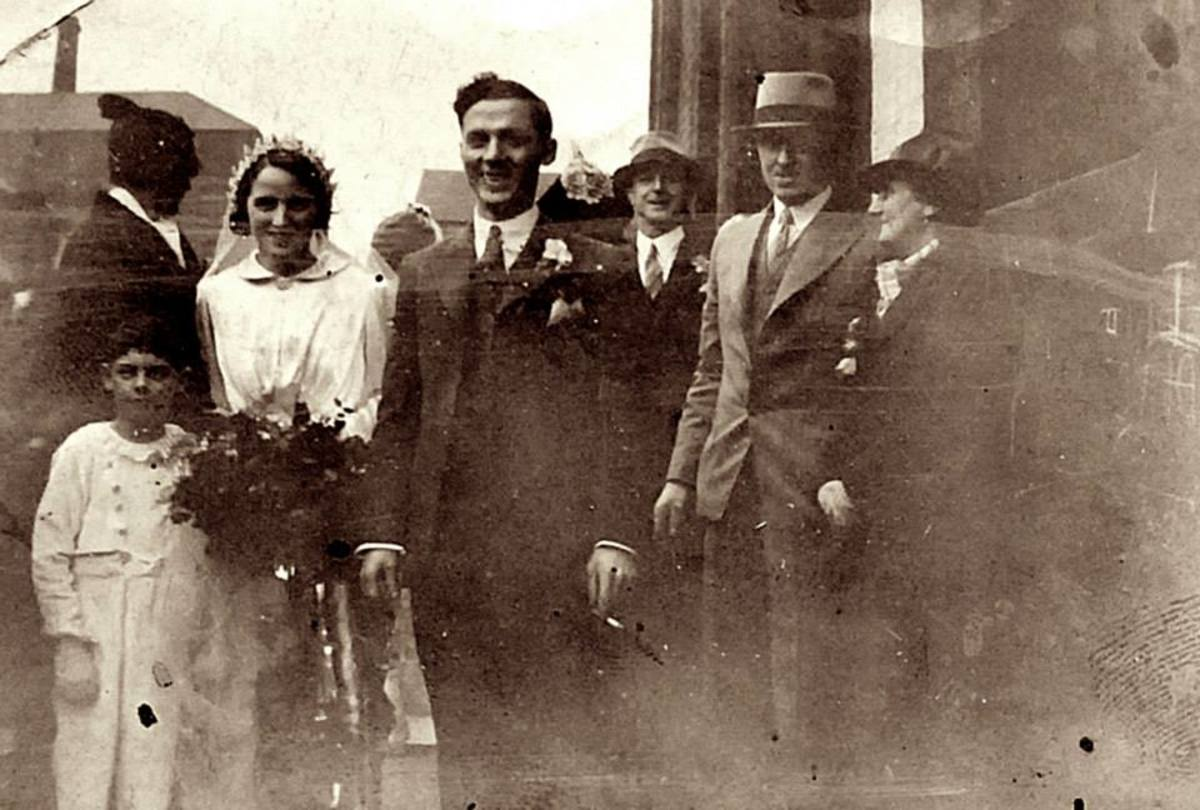 Mum's brother, Ken Trigg, is the young boy on the left, at a family wedding in the 1930s. It was the wedding of my grandad Frank Trigg's younger brother, Charlie, to Kitty. My great grandma (grandad's mum) is on the right.