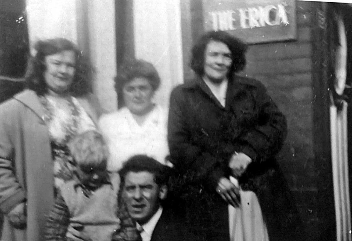 Grandad kneeling at the front with my brother Eric, grandma in the centre and guests at the bed & breakfast grandma ran, which was called The Erica