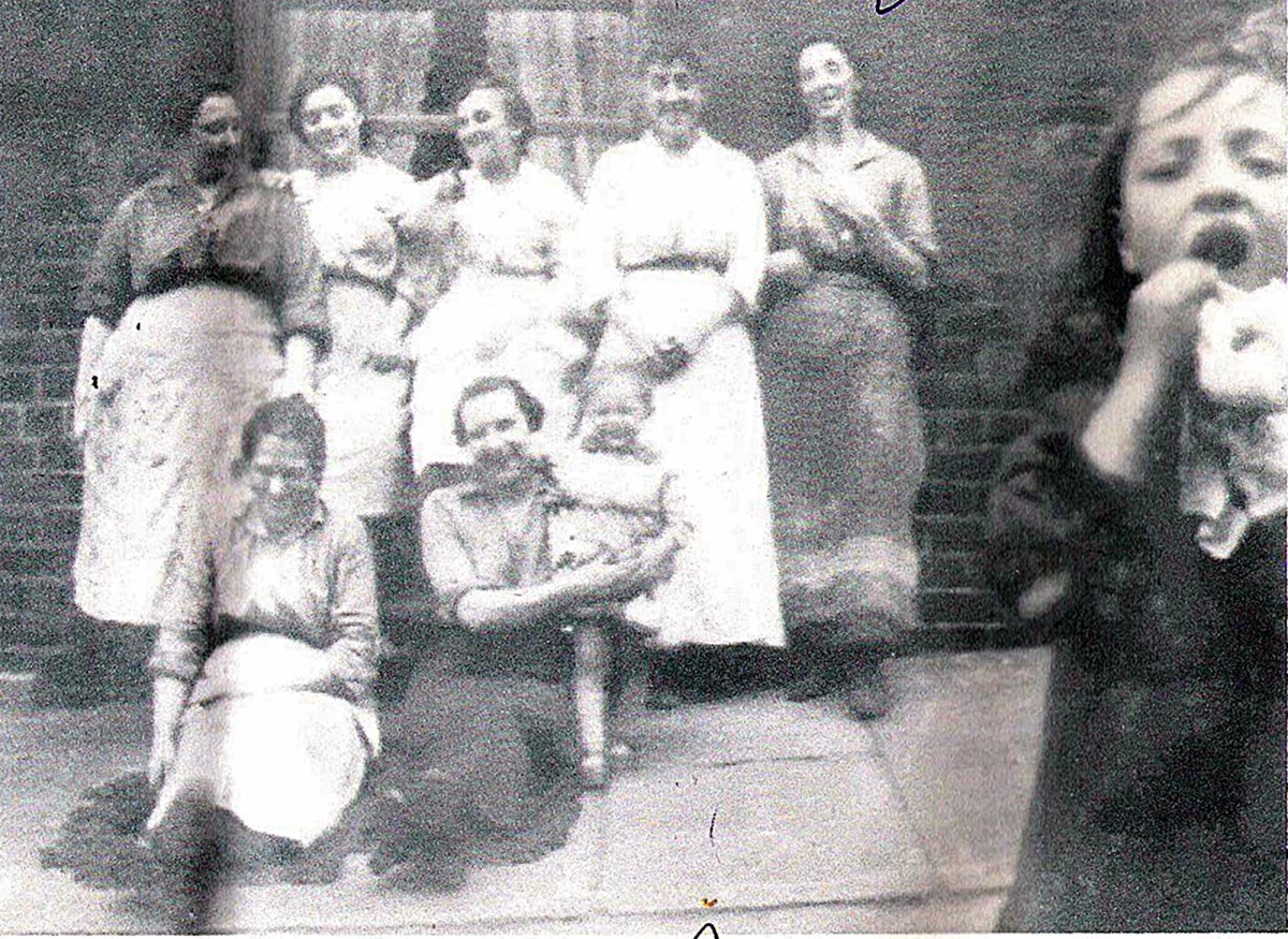 Grandad's mum Annie (standing in the centre) and her sister Mary (standing on the right) with their neighbours in Hunslet Carr around the time of World War One.