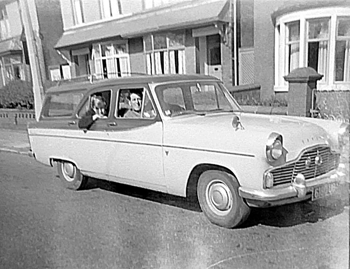 Grandad in his car with my brother Eric in the back, outside our old house where we grew up.