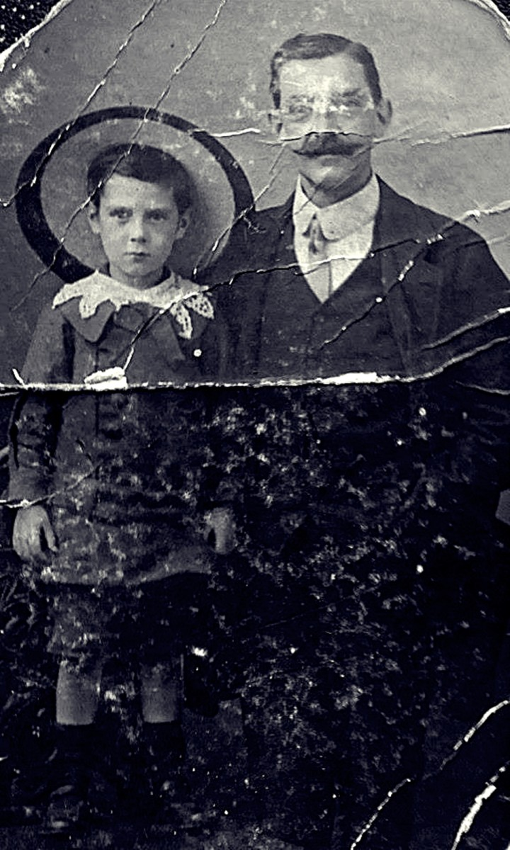 "Grandad as a young boy in around 1910, pictured with his father, in a photograph staged at a studio. They are wearing their ""Sunday best"", as a photo like this was a rare occurrence."