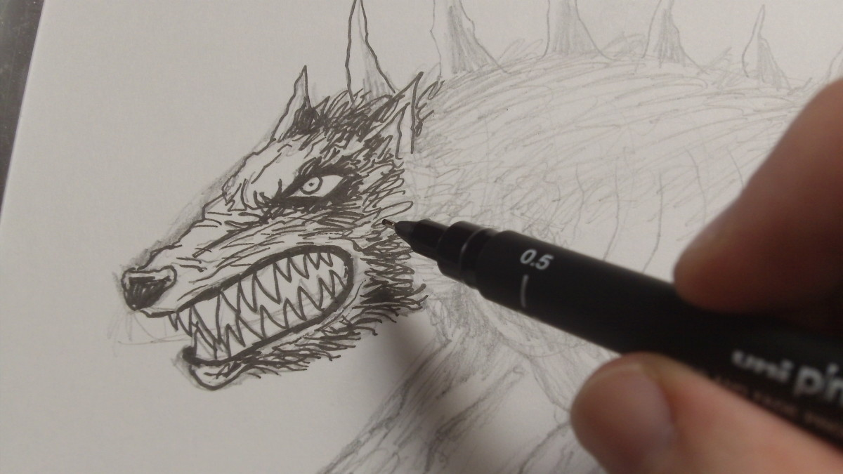 Drawing the teeth and hair around the head and other details.