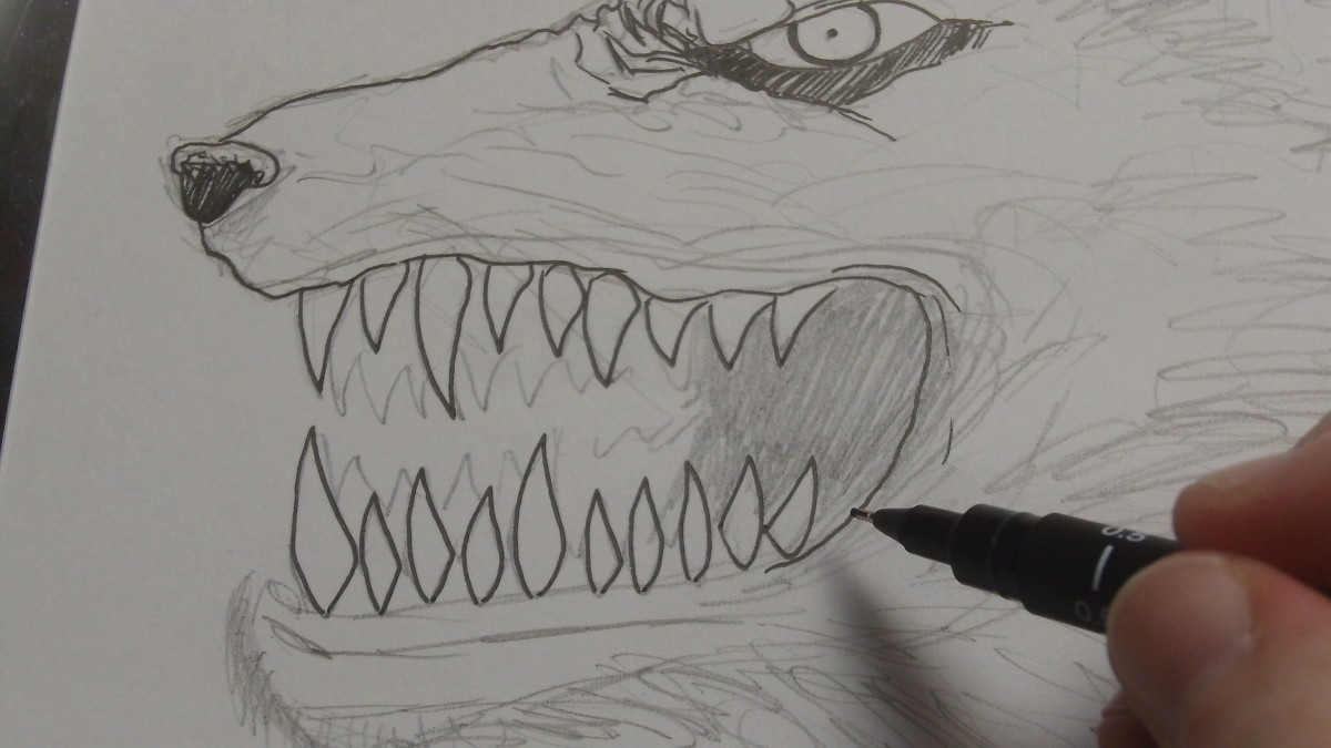 Going over the teeth with an ink pen.