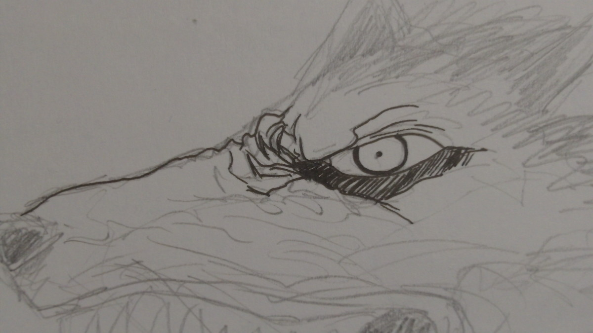 Inking starting with the eye of the Demon Dog.