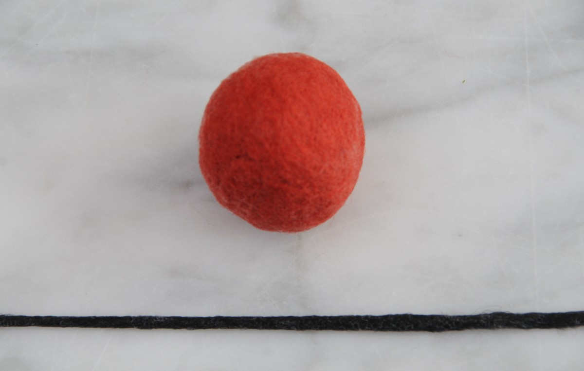 Wet a a thin piece of wool roving as shown