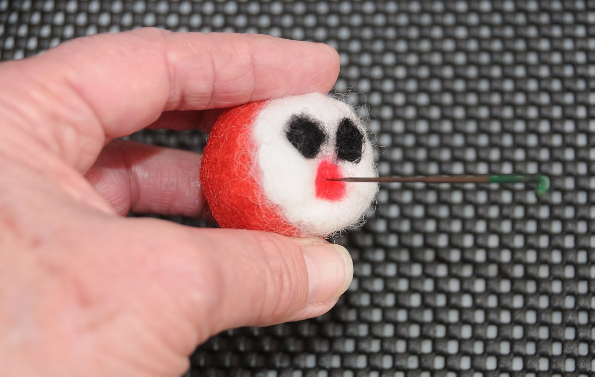 Add a pink or red mouth to the ladybug's face