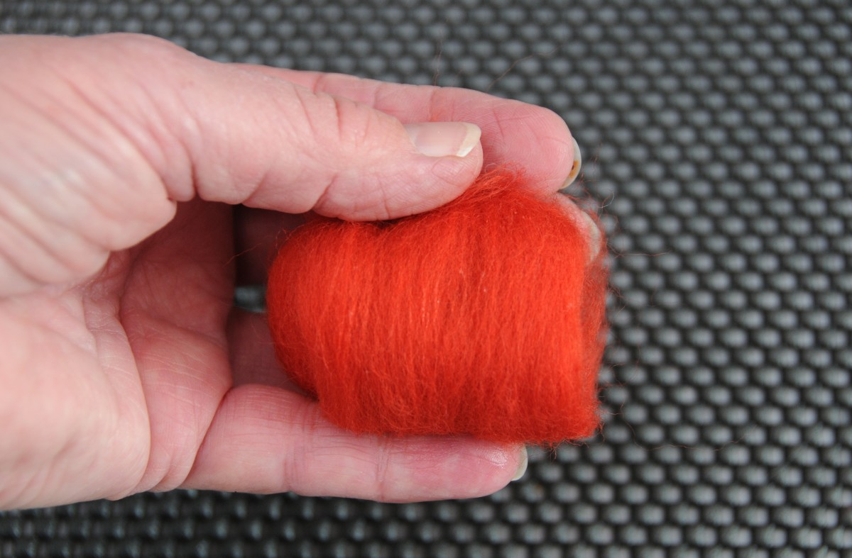Wrapping the excess wool roving over the knot