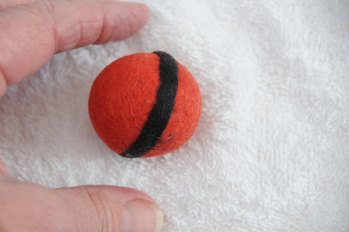 Rolling on a cloth appear to make it easier - felting happens more quickly when the project is not too wet
