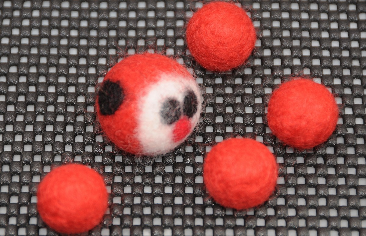 A completed ladybug with a selection of soon be baby ladybugs
